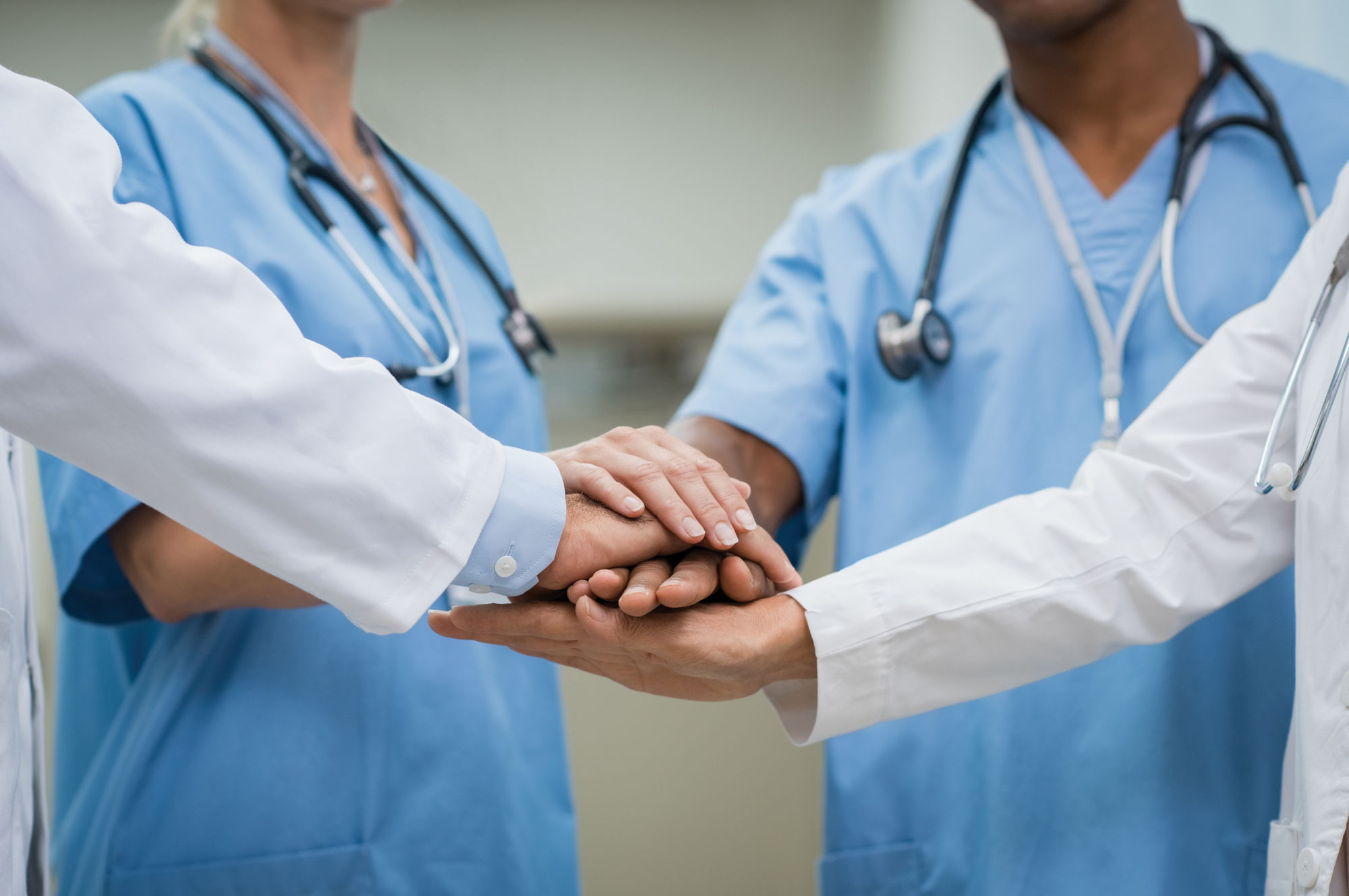 Medical staff hands stacked on each other in comradery